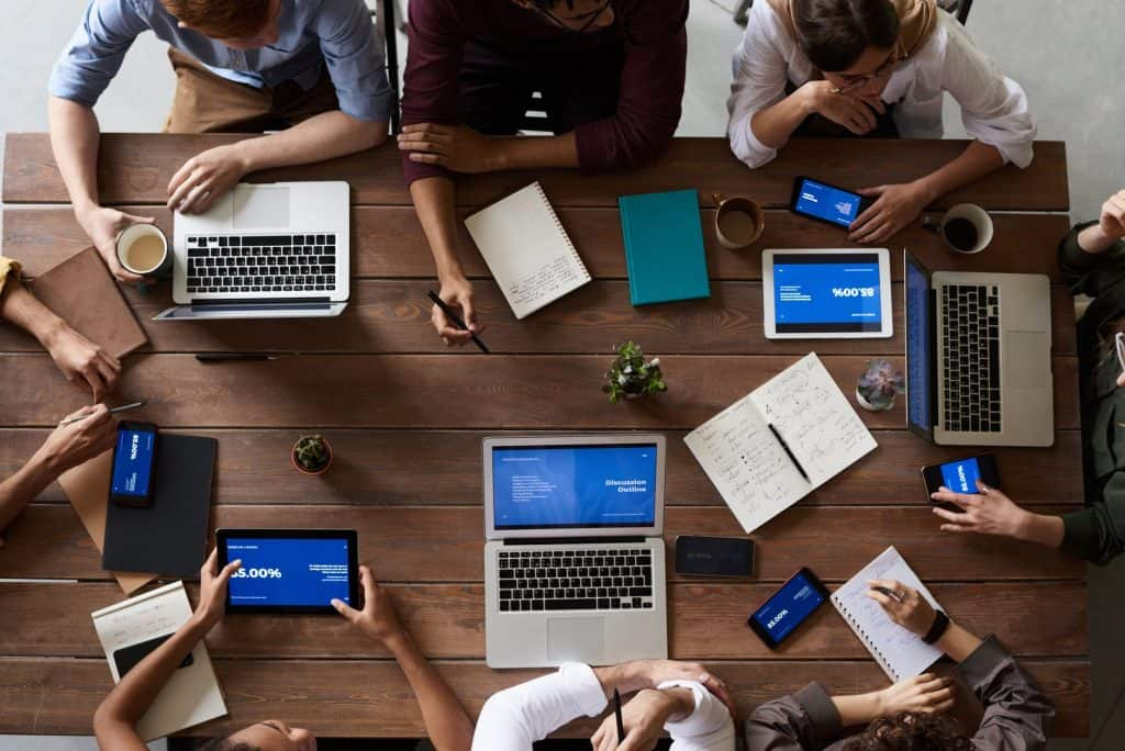 team of people working together on computers